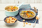 Veggie and mushroom soup with croutons