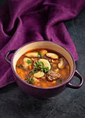 Beef and bean soup on purple background