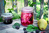 Pear blackberry preserves on the garden table