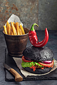 Purgatory burger and french fries on black slate