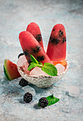 Watermelon blackberry popsicles in bowl with mint