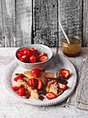 French toast with strawberries and caramel sauce