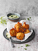 'Krebelcher' sheep's cheese doughnuts with a herb dip