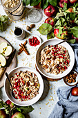 Oatmeal with apple, cinnamon, pecans, and pomegranate for breakfast