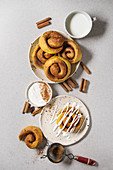 Homemade pumpkin cinnamon bun rolls sweet autumn baked dessert with cream cheese sauce