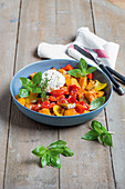 Pumpkin ratatouille with pepper, aubergine and goat's cheese