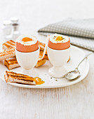Two soft boiled eggs with toast soldiers