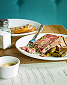 Ham hock terrine with parsley, guerkins and white toasted bread