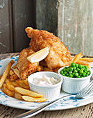 Fish and chips, peas and mayonaise
