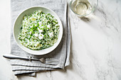 Spinach risotto with a glass of white wine