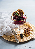 Frozen soya yoghurt with blackberries and waffle biscuits, vegan
