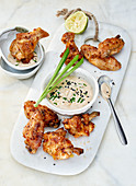 Chicken wings with a soya poke mayonnaise on a white marble board