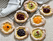 Vegan fruit and vanilla tartlets with cherries, kiwi, blueberries and mandarins