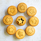 Gingerbread fruit mince pies with a star shape on the pastry lids