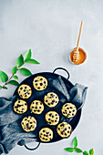 Chocolate chips zucchini muffins served in a black tray with a grey linen