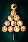 A Christmas tree made using gingerbread fruit mince pies and cinnamon sticks