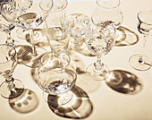 Empty glasses on a yellow background