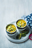 Potato and cheese soup with corn and avocado