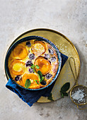 Peach clafoutis with black cherries