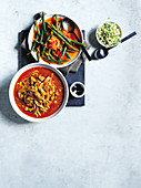 Harissa chicken curry with braised beans and couscous