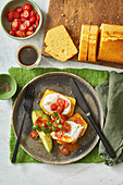 Cornbread with poached eggs, cherry tomatoes and avocado