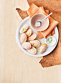 Lime sugar madeleines with grapefruit icing