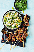 Chicken and cashew nut skewers with egg fried rice