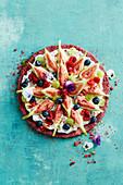 Vegan bircher muesli pizza with coconut yoghurt, figs and berries