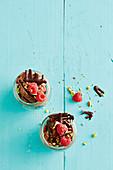 Vegan chocolate and coconut yoghurt-cream with frozen bananas and raspberries