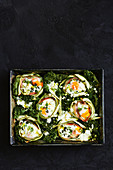 Zucchini rolls with egg and kale