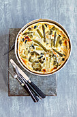 A green vegetable tart with asparagus, broccoli and zucchini