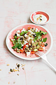 Quinoa and herb salad with olives and yoghurt
