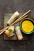 Vegetarian spring rolls with peanut and coconut sauce