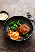 A salmon fillet with Indian broccoli and sweet potatoes