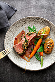 Rack of lamb with a herb crust and hasselback potatoes