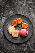 Leche frita with apricots and raspberry ice cream