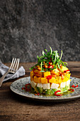 Mango, mozzarella, and avocado salad with acacia honey