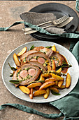 Stuffed beef breast with sausages and spinach
