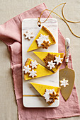 Christmas tart slices with cinnamon and nutmeg cream
