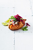 Sweet potatoes with chicken and jalapeno slaw