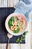 Asian noodle soup with radishes, pak choi and shrimp