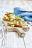Avocado and tomato scrambled eggs on toast