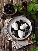 Quark dumplings on blackberry sauce