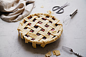 Uncooked berry pie with a lattice decoration on top