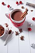 Hot chocolate with cinnamon sticks in a Christmas mug