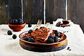 Thin chocolate pancakes with fresh blackberries