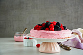 Cake with pink mascarpone cream and fresh berries