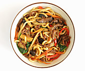 Noodles with beef, vegetables and corn cobs (Asia)
