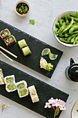 Various types of sushi with edamame