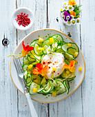 Cucumber salad with burrata and nasturtium flowers